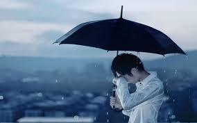 I hide my tears behind the rain