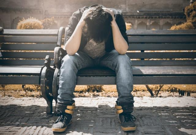 A Heartbroken boy feeling pain