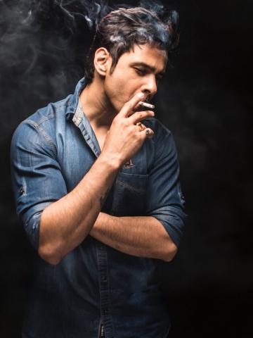 Sad Man taking cigarette