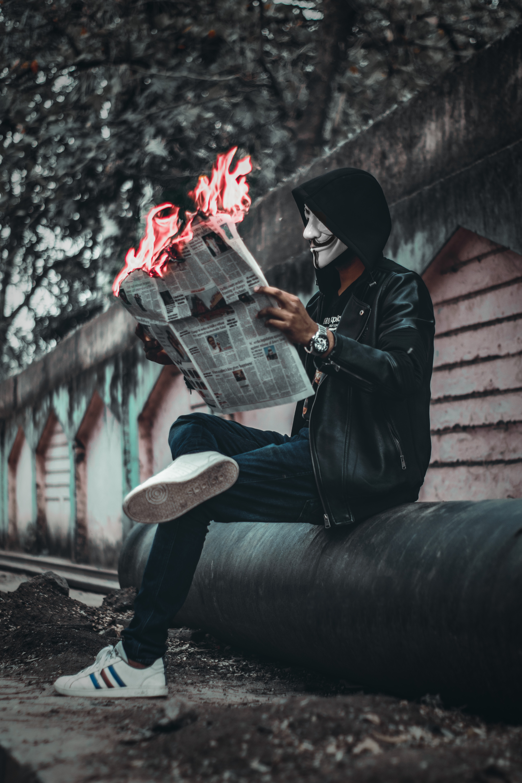 Alone boy reading newspaper