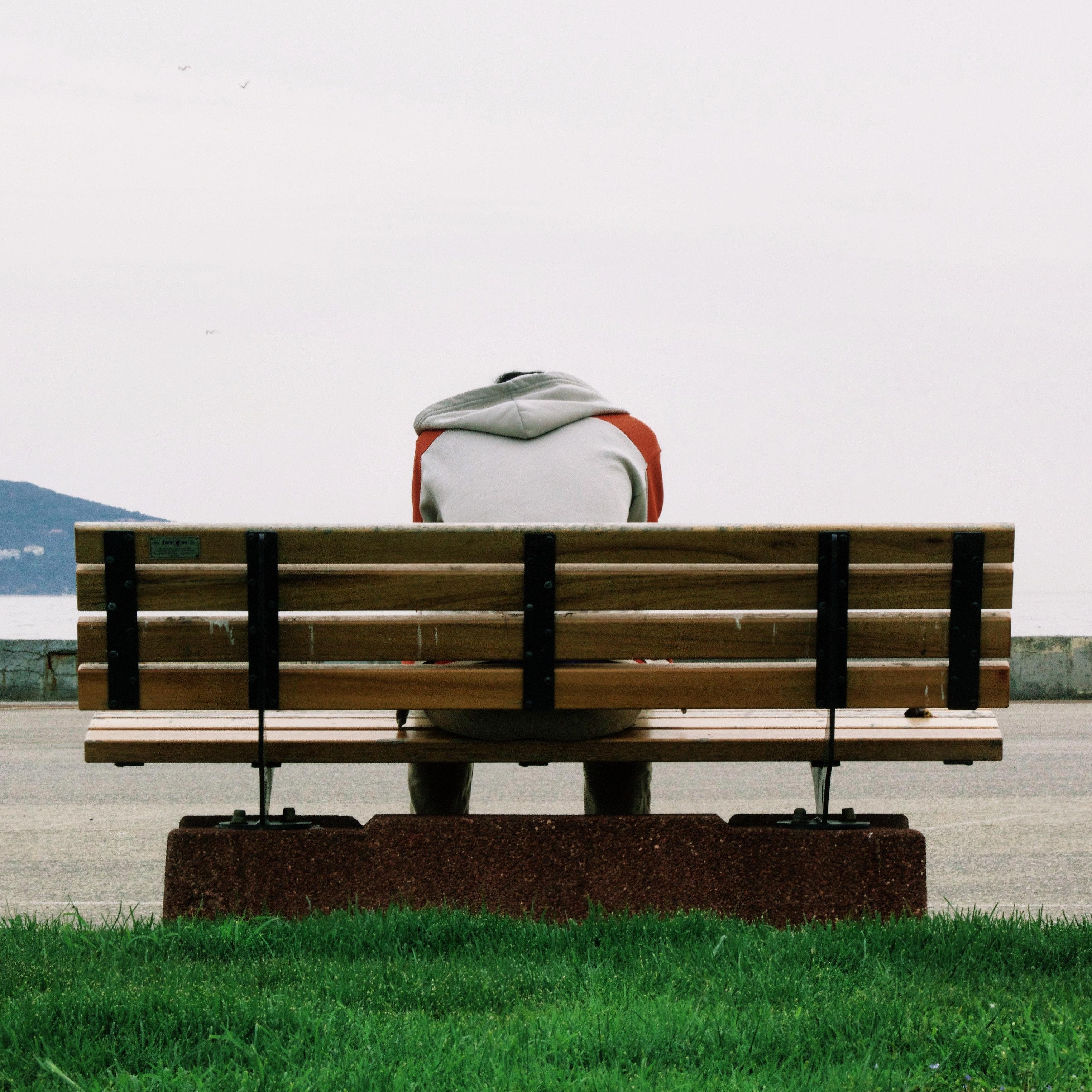 Boy Sad on bench backside