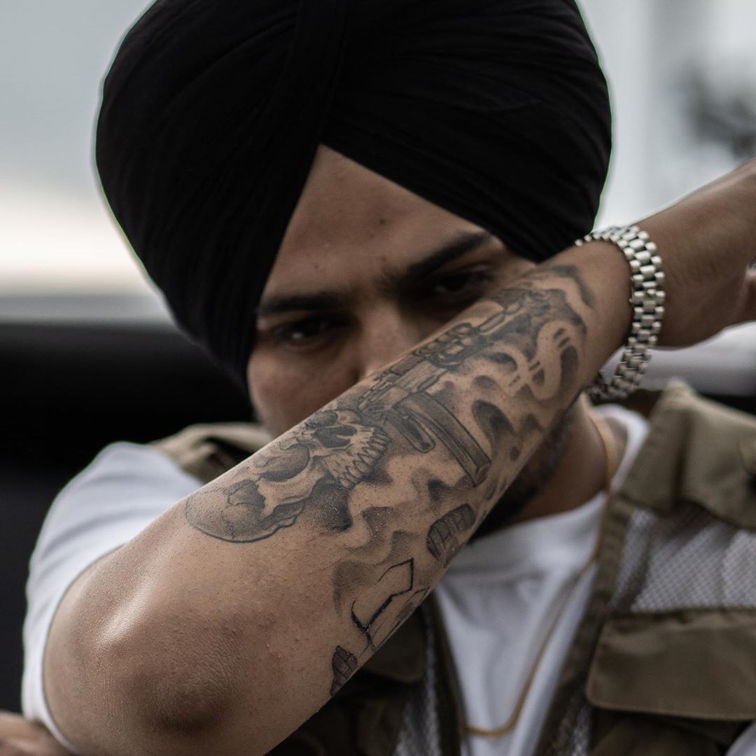 Sidhu moose wala tattoo on right arm