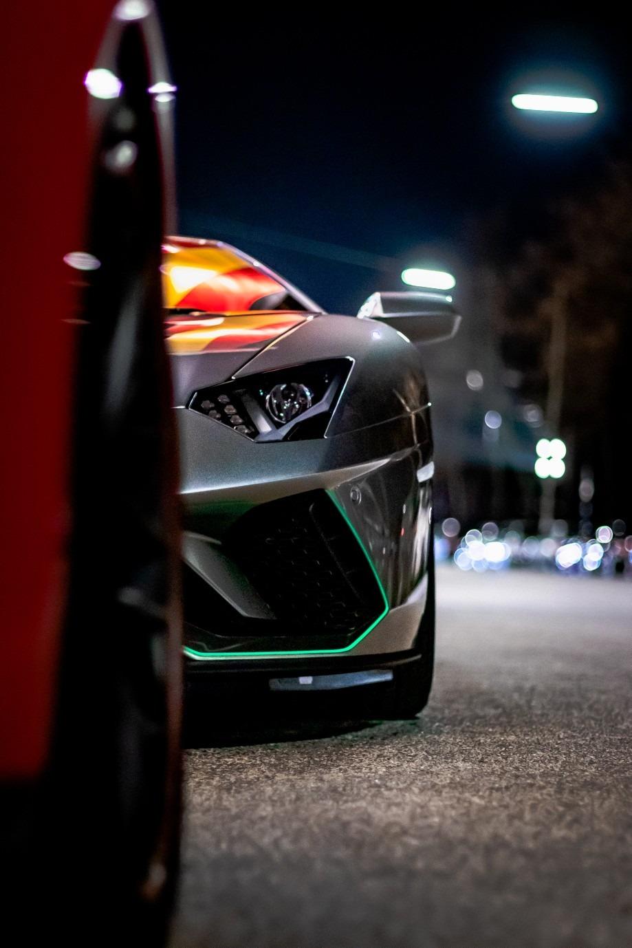 silver color Lamborghini on road.