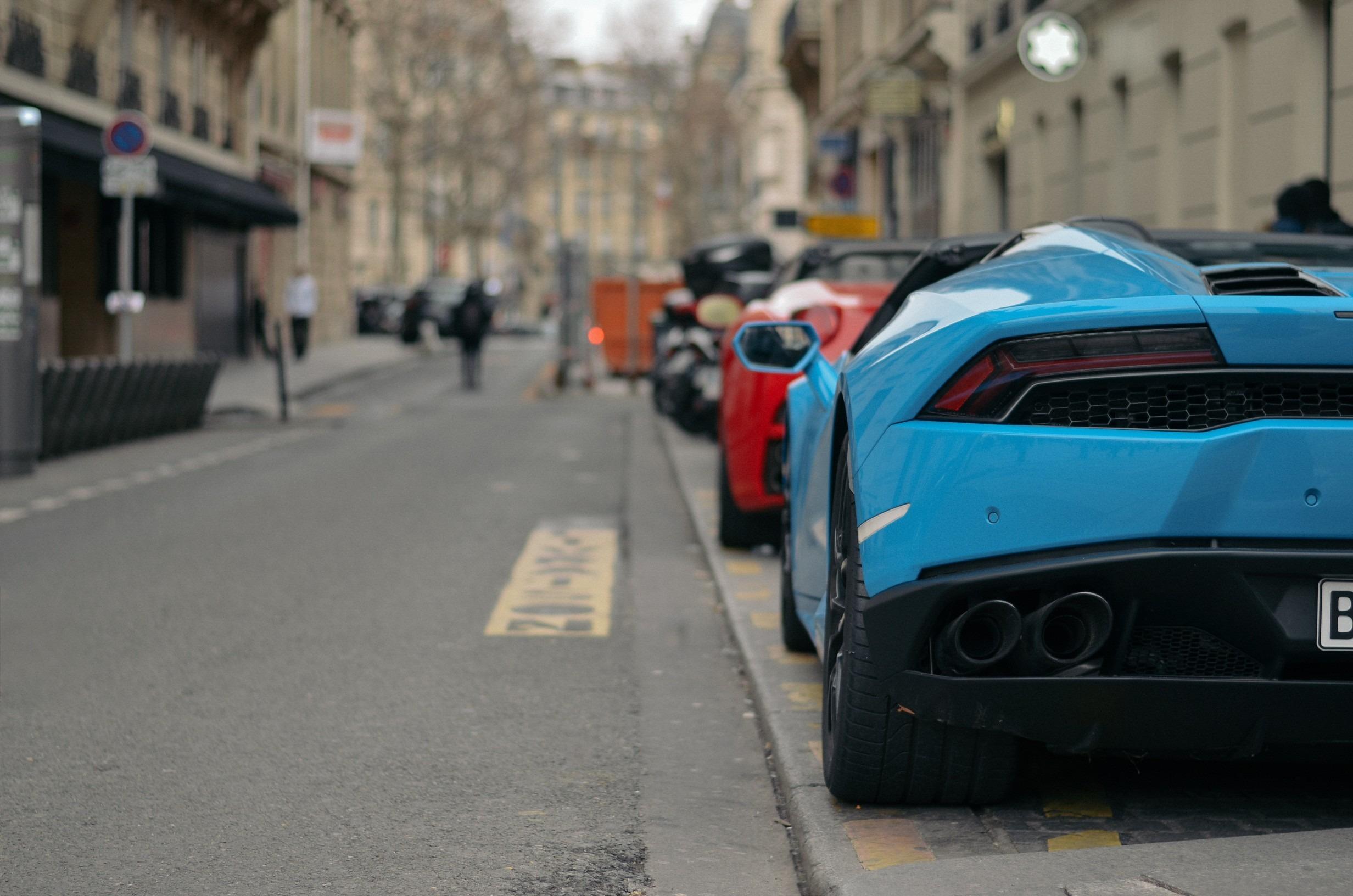Sky blue color Aventador park on side road