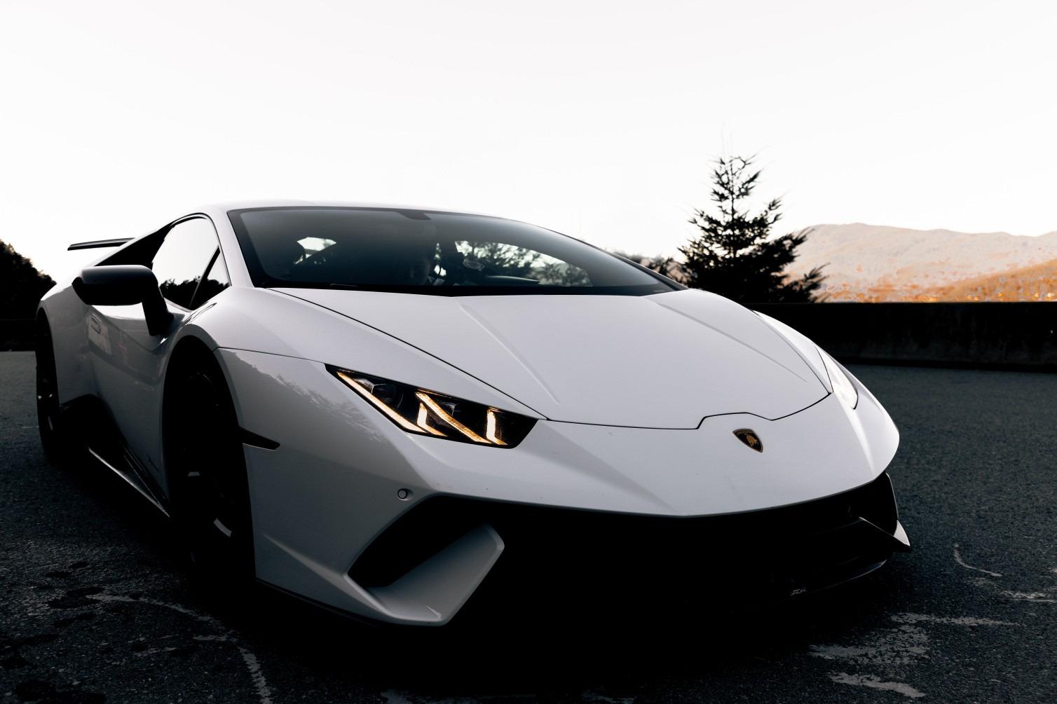 White Lamborghini Aventador on road