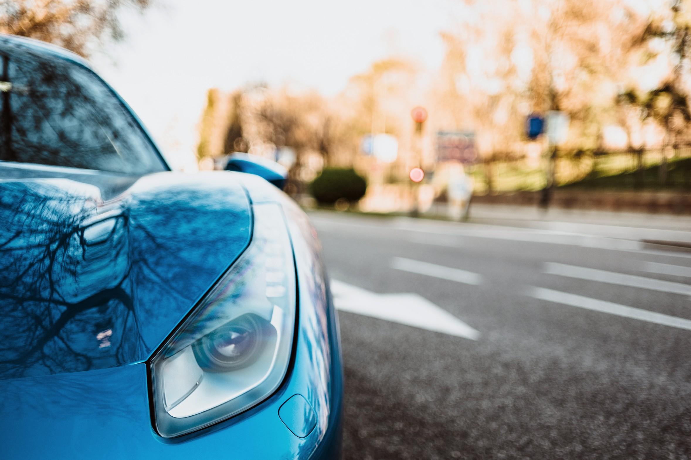 sky blue Lamborghini Aventador on the roadside.