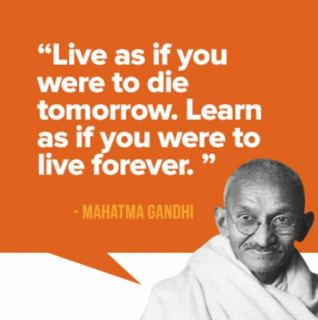 mahatma gandhi's photo is right down side. independence and life quote is wirte on orage aera.