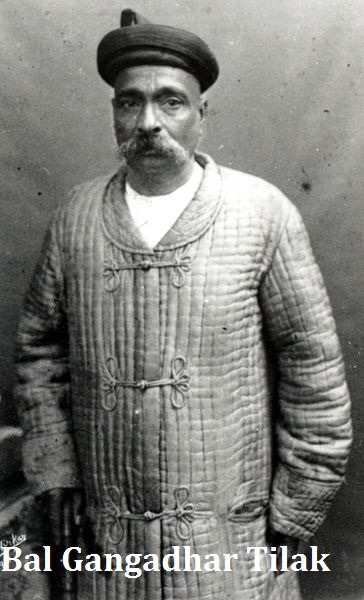 real photo of al gangdhar tilak. picture is is lblack and withe. he wear a coat and old a hat.