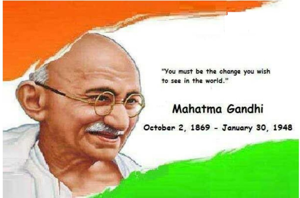 mahatma gandhi's photo in indian flag. his words and date of birth & death is wirtten down his name.