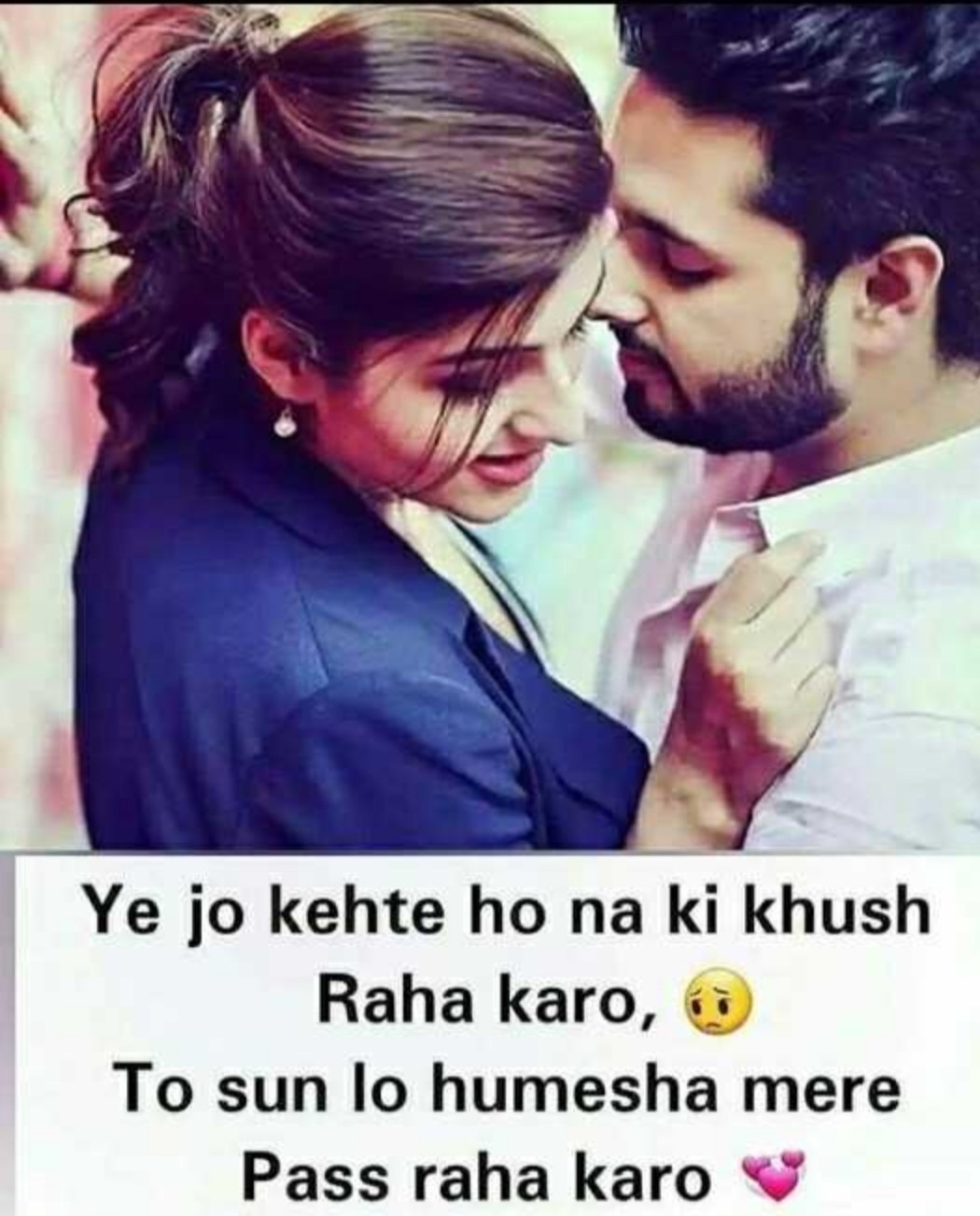 boy is very close to girl. girl is standing with wall. both's body each other. boy wear white shirt and girl wear blue coat. boy is looking to girl and girl is looking right side. love lines are wirtten in white area.