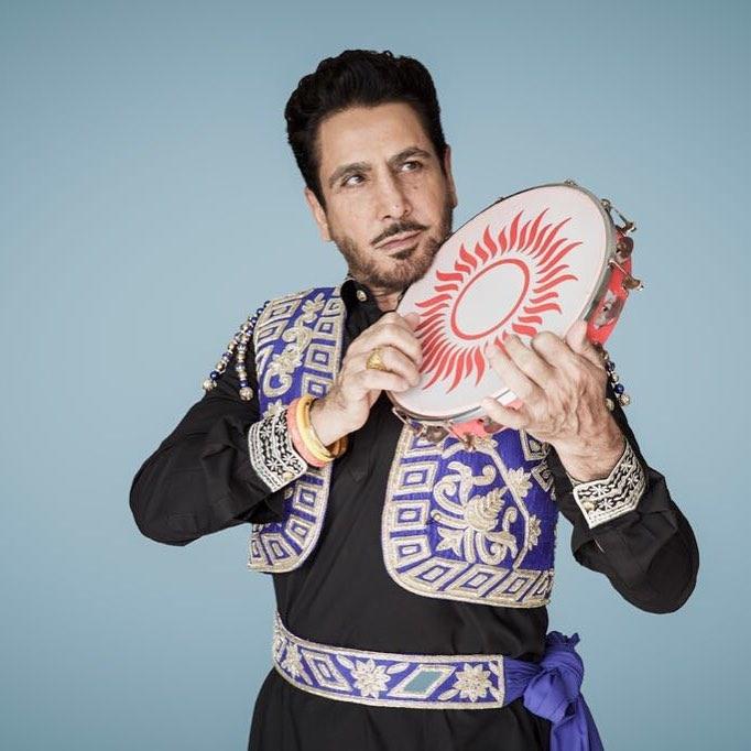 gurdas maan is in image. he have tambourines in his hand.